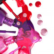 Ñolored nail polish  spilling from bottles — Photo