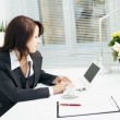 Businesswoman in the workplace — Stock Photo