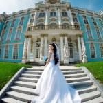 Luxury bride near palace — Stock Photo