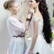 Stylist takes care of the bride — 图库照片