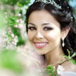 Beautiful bride in a blossoming garden — Stock Photo #11291634
