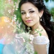 Stock Photo: Beautiful bride in a blossoming garden