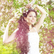 Beautiful bride in a blossoming garden — Stock Photo #11291658