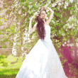 Beautiful bride in a blossoming garden — Stock Photo #11291660