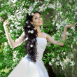 Beautiful bride in a blossoming garden — Stock Photo #11291667