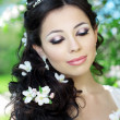 Beautiful bride in a blossoming garden — Stock Photo #11291670