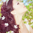 Beautiful bride in a blossoming garden — Stock Photo #11291674