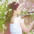 Beautiful bride in a blossoming garden — Stock Photo #11291689