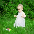 Stock Photo: Little pretty girl on a green lawn
