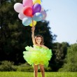 Ñhild with a bunch of balloons in their hands — Stock Photo #11291902