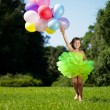 Ñhild with a bunch of balloons in their hands — Stock Photo #11291904