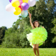 Ñhild with a bunch of balloons in their hands — Stock Photo #11291908