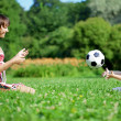 Stock Photo: Mother and son playing ball in the park.