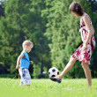 Mother and son playing ball in the park. — Стоковая фотография