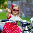 Girl in a red dress on a motorcycle — Stock Photo #11291969