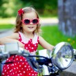 Girl in a red dress on a motorcycle — Stock Photo #11291974