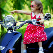Girl in a red dress on a motorcycle — Stock Photo #11291977