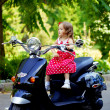 Girl in a red dress on a motorcycle — Stock Photo