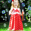 Royalty-Free Stock Photo: Cute little girl with bubbles
