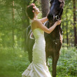 Woman and horse — Stock Photo #11292011