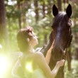 Woman and horse — Stock Photo #11292019