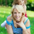 Mother and daughter hugging in the park — Stock Photo