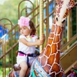 Girl riding on a carousel — Stock Photo #11292125