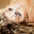 Stock Photo: Girl with an unusual make-up as a leopard