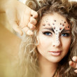 Girl with an unusual make-up as a leopard — 图库照片