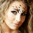 Girl with an unusual make-up as a leopard — Stock Photo