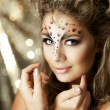 Girl with an unusual make-up as a leopard — Stock Photo #11292314