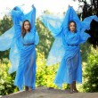 Stock Photo: Two woman, twins in the forest