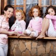 Three little girls, cute kids with mother — Stockfoto