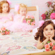 图库照片: Children in the nursery in pink dresses