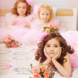 Children in the nursery in pink dresses — ストック写真