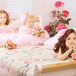 Children in the nursery in pink dresses — Stockfoto