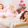 Children in the nursery in pink dresses - Lizenzfreies Foto