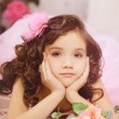 Girl in the nursery in pink dress — Foto Stock