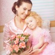 Stock Photo: Ñute little girl, a child in a dress with mother
