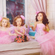 Children in the nursery in pink dresses — Stock Photo