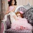 Two children on a chair in a nice dress — Stock Photo