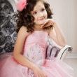 Child on chair in nice dress — Stock Photo #11292741