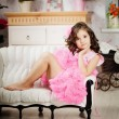 Girl in the nursery in pink dress — ストック写真