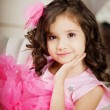 Girl in the nursery in pink dress — Foto de Stock