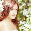 Beautiful girl in the lush spring garden — Stock Photo