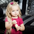 Little girl in a fashionable luxury interior — Stock Photo