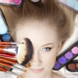 Stylist makeup artist with brushes and cosmetics — Photo