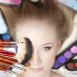 Stylist makeup artist with brushes and cosmetics — Stok fotoğraf