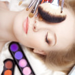 Professional stylist make-up brushes in their hands — Stock Photo #11292883