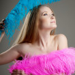 Beautiful girl with colorful feathers — Stock Photo #11293002